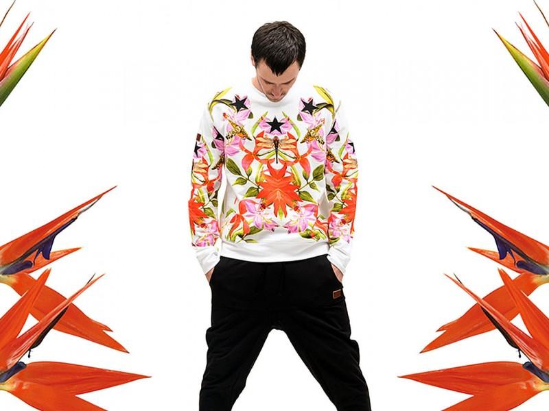 under two flags website menswear fashion model standing wearing floral sweatshirt